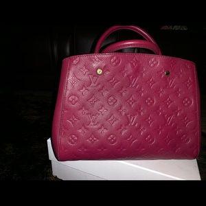 Authentic Louis Vuitton Montaigne purse